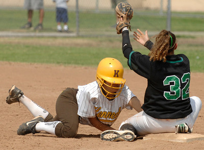 Kenedy High School #32 Rosheema Wise makes it back to 2nd base safely after a run down.  Granada Hills High School #32 Ana Izaguirre did not get the throw in time in a softball tournament played in Southgate, California on May 17, 2007. photo by John McCoy/LA Daily News