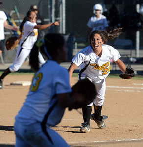 San Fernando pitcher Melinda Robertson #28 reacts at the final out for a 6-5 victory over Kennedy during their girls softball game Thursday, March 31, 2011 at Kennedy High School in Granada Hills. (Hans Gutkencht/Staff Photographer)