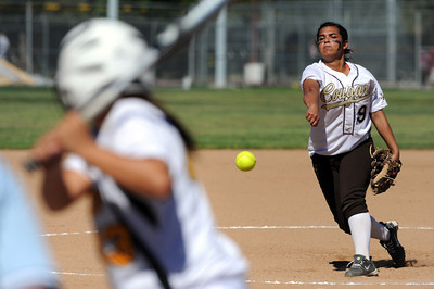 Kennedy pitcher Danielle Estrada #9 delivers to San Fernando's  Laura Aguilar #43 during their girls softball game Thursday, March 31, 2011 at Kennedy High School in Granada Hills. (Hans Gutkencht/Staff Photographer)
