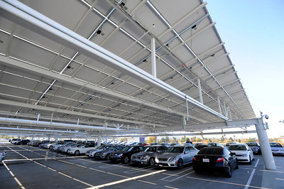 View of new cars parked on the roof under the array of solar pannels. Keyes European Llc. has opened up its new $35 Million Dollar dealership on Van Nuys Blvd. The new building includes a 3 story open atrium main showroom, with showrooms on two floors. A top level parking area is covered with solar panels. Van Nuys, CA 12/08/2011(John McCoy/Staff Photographer)