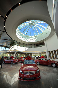 Keyes European Llc. has opened up its new $35 Million Dollar dealership on Van Nuys Blvd. The new building includes a 3 story open atrium main showroom, with showrooms on two floors. A top level parking area is covered with solar panels. Van Nuys, CA 12/08/2011(John McCoy/Staff Photographer)