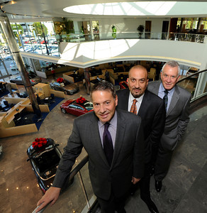 (l-r) Automotive Group VP Howard Tennenbaum, General Manager Simon Sarriedine, and President Howard Keyes stand on the second level above the main showroom. Keyes European Llc. has opened up its new $35 Million Dollar dealership on Van Nuys Blvd. The new building includes a 3 story open atrium main showroom, with showrooms on two floors. A top level parking area is covered with solar panels. Van Nuys, CA 12/08/2011(John McCoy/Staff Photographer)