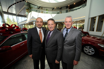 (l-r) General Manager Simon Sarriedine, Automotive Group VP Howard Tennenbaum, and President Howard Keyes stand in the main showroom. Keyes European Llc. has opened up its new $35 Million Dollar dealership on Van Nuys Blvd. The new building includes a 3 story open atrium main showroom, with showrooms on two floors. A top level parking area is covered with solar panels. Van Nuys, CA 12/08/2011(John McCoy/Staff Photographer)