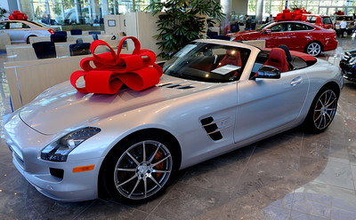 The 2012 SLS AMG Roadster sells for nearly a quarter of a million dollars. Keyes European Llc. has opened up its new $35 Million Dollar dealership on Van Nuys Blvd. The new building includes a 3 story open atrium main showroom, with showrooms on two floors. A top level parking area is covered with solar panels. Van Nuys, CA 12/08/2011(John McCoy/Staff Photographer)
