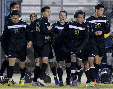 The Knights celebrate a second half goal. Knight defeated Palmdale 3-2 in a Golden League boys' soccer match. Palmdale, CA 2/1/2012(John McCoy/Staff Photographer)