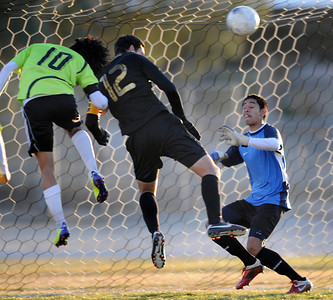 Palmdale#10 Corey Nieto can not get the ball past Knight#12 Alexis Soto and Knight#25 Hector Leon in the first half of play. Knight defeated Palmdale 3-2 in a Golden League boys' soccer match. Palmdale, CA 2/1/2012(John McCoy/Staff Photographer)