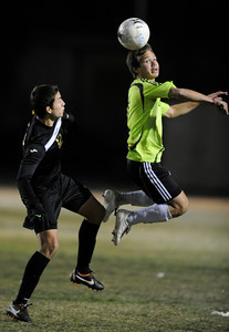 Palmdale#2 Steve Ramirez heads the ball away from Knight#12 Alexis Soto. Knight defeated Palmdale 3-2 in a Golden League boys' soccer match. Palmdale, CA 2/1/2012(John McCoy/Staff Photographer)