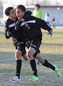 Knight#5 Angel Cova gets a kiss on the cheek from Knight#13 Jessie Reyes after scoring a goal in the first half of the game. Knight defeated Palmdale 3-2 in a Golden League boys' soccer match. Palmdale, CA 2/1/2012(John McCoy/Staff Photographer)