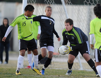 Palmdale#15 Christian Martinez and Palmdale#1 Angel Ramirez don't let Knight#7 Randall McDermott get past them. Knight defeated Palmdale 3-2 in a Golden League boys' soccer match. Palmdale, CA 2/1/2012(John McCoy/Staff Photographer)