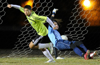 Palmdale#9 Jose Tobar gets a ball past goalie Knight#1 Guillermo Castro. Knight defeated Palmdale 3-2 in a Golden League boys' soccer match. Palmdale, CA 2/1/2012(John McCoy/Staff Photographer)