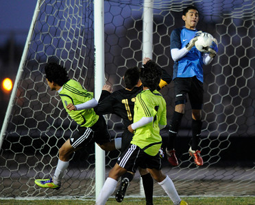 Knight#25 Hector Leon makes a save. Knight defeated Palmdale 3-2 in a Golden League boys' soccer match. Palmdale, CA 2/1/2012(John McCoy/Staff Photographer)