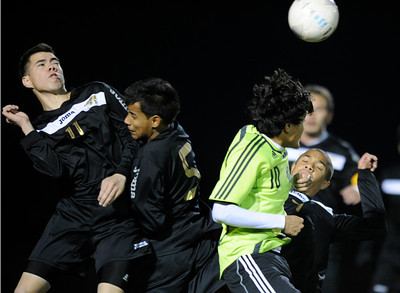 Palmdale#10 Corey Nieto is caught between Knight#11 Kirk Mancia Knight#5 Angel Cova and Knight#7 Randall McDermott in the second half. Knight defeated Palmdale 3-2 in a Golden League boys' soccer match. Palmdale, CA 2/1/2012(John McCoy/Staff Photographer)