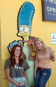 left to right are Maeve McGrath and Danielle Mays pose next to Marge at the 7-Eleven which has been changed to a Kwik-E-Mart for the upcoming Simpson's movie.  Both women worked on the movie and came by to visit the store on Monday, July 2, 2007 in Burbank, Ca.  (Tina Burch/Staff Photographer)