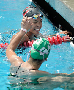 Cleveland swimmer Cleveland Whitney Lam and Alyssa Lara  (in green cap) shake hands after the girls 200 year Freestyle in the LA City Section CIF, All City Swimming Championships were held at the AAF/John C. Argue Swim Stadium in Los Angeles, CA 5-17-2011. (John McCoy/staff photographer)