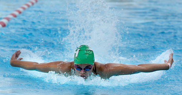 Granada Hills Bianca Valencia swims in the 100 yard butterfly during  the LA City Section CIF, All City Swimming Championships that were held at the AAF/John C. Argue Swim Stadium in Los Angeles, CA 5-17-2011. (John McCoy/staff photographer)