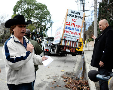 (R) City Councilman Dennis Zine with transportation officials and police talks during a press conference and is interrupted by Bob Boyer who runs a alarm business and one of the mobile billboard businesses, who had many of his mobile trailers towed by the Mobile Billboard Task Force to crack down on mobile billboards Canoga Park Ca. .Jan 3,2011 Photo by Gene Blevins/LA DailyNews