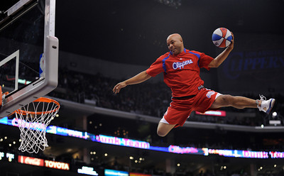 The LAC Dunk Crew flies high for the crowd during a time out in the first half of the game. The Clippers defeated the Phoenix Suns 103 to 86  in a game played at Staples Center in Los Angeles, CA 3/28/2012(John McCoy/Staff Photographer)