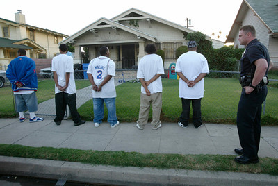 7-24-04 South Los Angeles)LAPD officers question gang members in South Los Angeles (Hans Gutknecht/LA Daily News)
