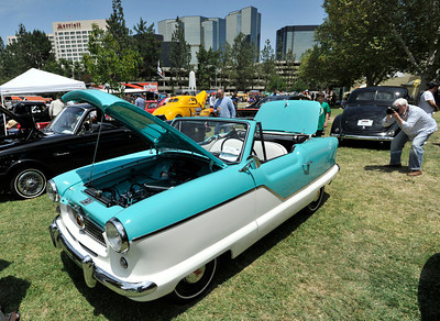 A man takes a photo of a 1959 Metro. The Los Angeles Police Department Valley Traffic Division is held its 8th annual Car Show & Traffic Safety Fair at Warner Center Park Saturday. Woodland Hills, CA 6-4-2011. (John McCoy/Staff Photographer)