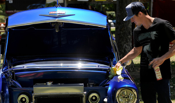 Frank Tesoro, from Westlake Village dusts off his fathers 56 Chevy Bel Air. The Los Angeles Police Department Valley Traffic Division is held its 8th annual Car Show & Traffic Safety Fair at Warner Center Park Saturday. Woodland Hills, CA 6-4-2011. (John McCoy/Staff Photographer)