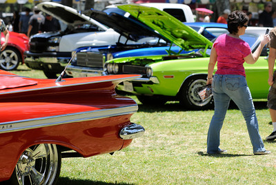 Fans of fins check out vintage rear-ends. The Los Angeles Police Department Valley Traffic Division is held its 8th annual Car Show & Traffic Safety Fair at Warner Center Park Saturday. Woodland Hills, CA 6-4-2011. (John McCoy/Staff Photographer)