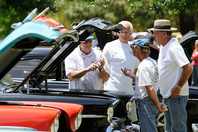 Vintage Chevy fans from the 55, 56, 57 Chevy Club talk about their motors. The Los Angeles Police Department Valley Traffic Division is held its 8th annual Car Show & Traffic Safety Fair at Warner Center Park Saturday. Woodland Hills, CA 6-4-2011. (John McCoy/Staff Photographer)