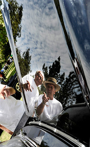 (l-r) Jerome Ruzicka and Alan Donath are reflected in the hood of Donaths 57 Chevy. The Los Angeles Police Department Valley Traffic Division is held its 8th annual Car Show & Traffic Safety Fair at Warner Center Park Saturday. Woodland Hills, CA 6-4-2011. (John McCoy/Staff Photographer)
