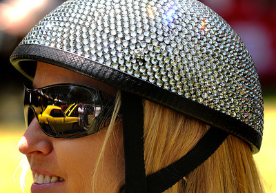 Abigail Moderhak from Simi Valley wears one of one of the items she is selling at her Bling Helmets booth, while catching the reflection of a 69 Camaro in her sun glasses. The Los Angeles Police Department Valley Traffic Division is held its 8th annual Car Show & Traffic Safety Fair at Warner Center Park Saturday. Woodland Hills, CA 6-4-2011. (John McCoy/Staff Photographer)