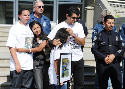 Juan Jose Romero, sister Alani Romero and mother Maria Romero during a press conference by LAPD to announce the arrests of Dominique Rush and her father Steven Rush in the death of their brother and son German Alex Romero, a 17-year-old who was struck by a car and killed on April 20, 2011 in a hit and run. Dominique is suspected of driving the car that struck Romero and her father Steven of helping in an attempt to cover up the crime. (Hans Gutknecht/Staff Photographer)
