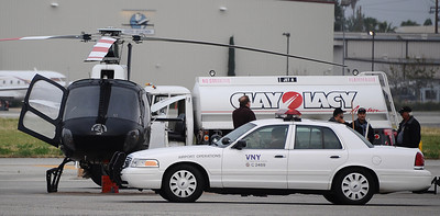 A LAPD helicopter had to make a emergency landing at the Van Nuys airport early thing morning after it was shot at and started smoking. A suspect shot at the helicopter with a rifle from the area of Cohasset St. and Gloria Ave. None of the LAPD pilots were hurt and family members of the suspect were able to convince him to give up to police.  Van Nuys CA. April 24,2011.  Photo by Gene Blevins/LA Daily News