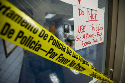 Signs warn officers from walking on the newly installed tiling in the watch commander's office. Rodriguez hopes that the office will be finished by Friday, July 1, 2011. The Los Angeles Police Department's Foothill Station in Pacoima, Calif. is undergoing renovations with the help of donations from local businesses and residents. New tiling, freshly painted walls and updated furniture are among the changes to the station, which is in its 50th year Ð one of the oldest in the department.  (Maya Sugarman/Staff Photographer)