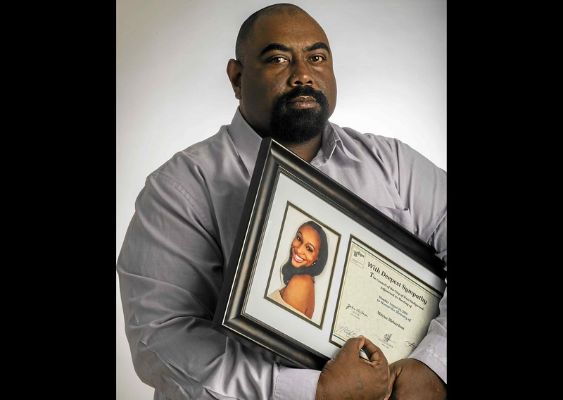 . In an April 2015 photo, Michael Richardson holds a portrait of his daughter Mitrice Richardson, who went missing in 2009 and was found dead in 2010. Her family settled a civil lawsuit with the sheriff�s department in 2012 for the mishandling of the case. The family still does not know what happened to Mitrice. (File photo by Thomas R. Cordova/Daily Breeze)
