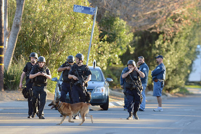 Los Angeles Police K-9 officers prepare to search on Manton Ave after a man shot a police officer was shot on Manton Ave near El Camino High School in Woodland Hills. (Hans Gutknecht/Staff Photographer)