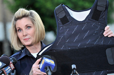 During a press conference in front of Northridge Hospital Medical CenterPolice Officer, Karen Ranier holds up an example of a bullet proof vest that was worn by the Cop,LAUSD Police officer Jeffrey Stenroos, who was shot at El Camino Real High School. Northridge, CA 1-19-2011.