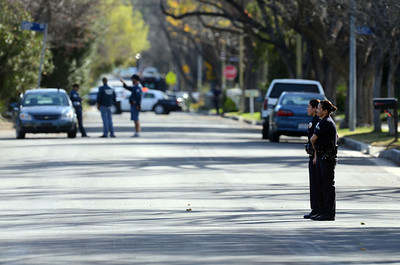 Los Angeles Police officers on Manton Ave after a man shot a police officer  in Woodland Hills. (Hans Gutknecht/Staff Photographer)