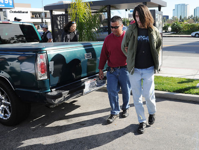 Los Angeles Police take a man matching the description of a suspect that shot a police officer in Woodland Hills.  The man was spotted at Victory Blvd and Topanga Canyon by citizens who then phoned the police. (Hans Gutknecht/Staff Photographer)
