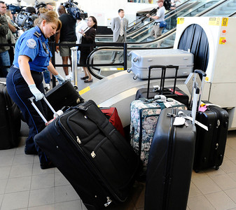 TSA agents scan luggage during a press conference at Los Angeles International Airport  about how air travel has changed since the terrorist attacks of Sept 11,2001, and provide an overview of the numerous security measures implemented at LAX during the past 10 years.Sept 7,2011 photo by Gene Blevins/LA DAILYNEWS