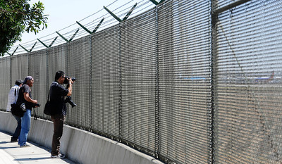 A new fencing that has gone up around the airport during a press conference at Los Angeles International Airport  about how air travel has changed since the terrorist attacks of Sept 11,2001, and provide an overview of the numerous security measures implemented at LAX during the past 10 years.Sept 7,2011 photo by Gene Blevins/LA DAILYNEWS