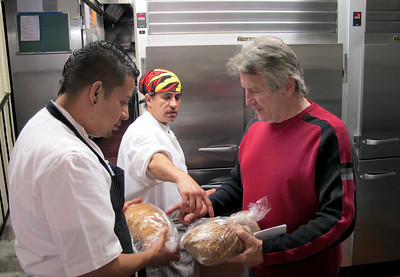 La Frite Cafe on Ventura Blvd. in Sherman Oaks Ca.  Andre Ramillon, right, works with kitchen chefs before lunch service.  (Dean Musgrove/Staff Photographer)