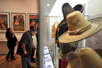 """People look at the museum exhibit at La Plaza, Los Angeles' first Mexican American cultural center. The center is celebrating its grand opening with entertainment, workshops and tours of an exhibit titled, """"LA Starts Here!"""" The center is located at 501 North Main Street in Los Angeles, just across the street from Olvera Street. Los Angeles, CA 4-16-2011. (John McCoy/staff photographer)"""