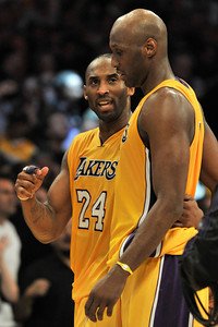 Lamar Odom and Kobe Bryant after the win. The Lakers defeated the Houston Rockets 114 to 106 in a game played at Staples Center in Los Angeles, CA. 2-1-2011. (John McCoy/staff photographer)