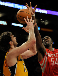Pau Gasol and Patrick Patterson battle for a loose ball. The Lakers defeated the Houston Rockets 114 to 106 in a game played at Staples Center in Los Angeles, CA. 2-1-2011. (John McCoy/staff photographer)