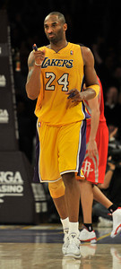 Kobe Bryant points to the bench as the victory is in hand during overtime. The Lakers defeated the Houston Rockets 114 to 106 in a game played at Staples Center in Los Angeles, CA. 2-1-2011. (John McCoy/staff photographer)