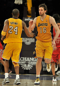 Kobe Bryant congratulates Pau Gasol after the center made freethrows at the end of the game. The Lakers defeated the Houston Rockets 114 to 106 in a game played at Staples Center in Los Angeles, CA. 2-1-2011. (John McCoy/staff photographer)