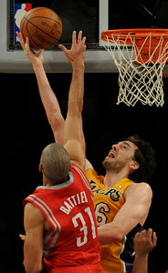 Pau Gasol lays in two points against Shane Battier. The Lakers defeated the Houston Rockets 114 to 106 in a game played at Staples Center in Los Angeles, CA. 2-1-2011. (John McCoy/staff photographer)