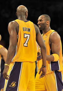 Kobe Bryant and Lamar Odom congratulate eachother. Lakers congratulate eachother in the final second of their victory. The Lakers defeated the Houston Rockets 114 to 106 in a game played at Staples Center in Los Angeles, CA. 2-1-2011. (John McCoy/staff photographer)