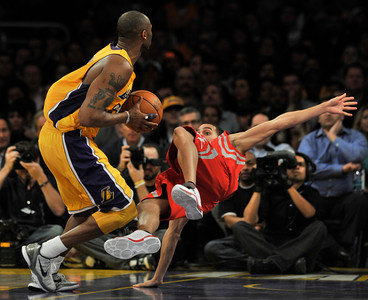 Kobe Bryant runs over Kevin Martin and is called for a fould The Lakers defeated the Houston Rockets 114 to 106 in overtime in a game played at Staples Center in Los Angeles, CA. 2-1-2011. (John McCoy/staff photographer)