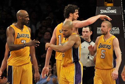 Lakers congratulate eachother in the final second of their victory. The Lakers defeated the Houston Rockets 114 to 106 in a game played at Staples Center in Los Angeles, CA. 2-1-2011. (John McCoy/staff photographer)