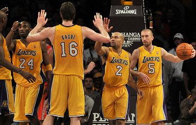Pau Gasol gets congratulations for team mates when he made freethrows in the final moments. The Lakers defeated the Houston Rockets 114 to 106 in a game played at Staples Center in Los Angeles, CA. 2-1-2011. (John McCoy/staff photographer)