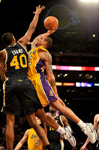 Jeremy Evans fouls Shannon Brown in the forth quarter. The Lakers defeated the Utah Jazz 120 to 91 in a game played at Staples Center in Los Angeles ,CA 1-25-2011. (John McCoy/staff photographer)